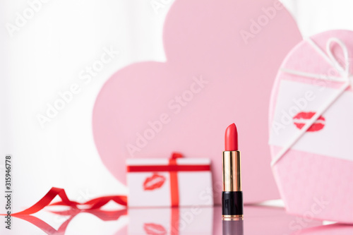 Fotografiet valentines day gift box red lipstick on the red background