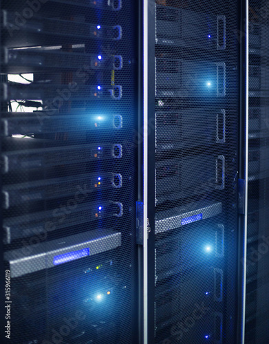Vertical Format. Rows of server racks. Blue Technology Backfround.