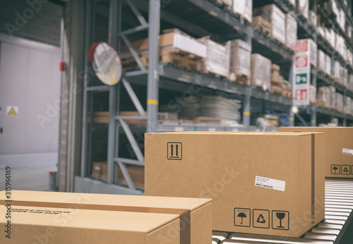 Cuadros en Lienzo Cardboard boxes on conveyor rollers inside a warehouse ready to be shipped by co
