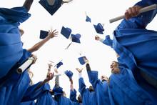 Graduate Throwing Caps In The ...