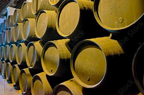 Carta da parati The row of black sherry casks, Jerez, Spain