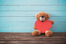 Teddy Bear With Red Heart On Old Wooden Background. Valentine's