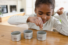 Young Girl Learning Money Conc...
