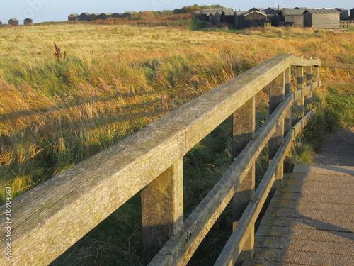 Billede på lærred Landscape view Walberswick near Southwold over the wooden bridge that leads to t