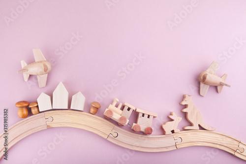 Fototapeta Zero waste. Eco wooden toys on pink background. Flat lay. Top view obraz