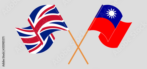Photo Crossed and waving flags of Taiwan and the UK