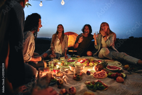 Obraz Group of friends making barbecue in the nature. - fototapety do salonu