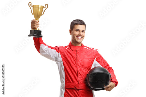 Fotografia Young male car racer standing and holding a helmet and a gold trophy cup