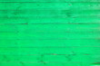 Leinwanddruck Bild - Light green painted wooden fence made of pine boards, green wall background, pine wood texture