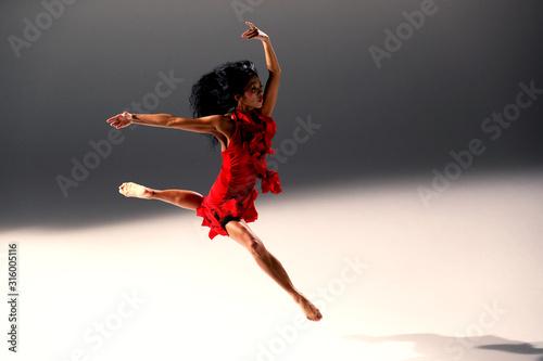 Fotografie, Tablou A slender girl in a pink skirt and beige top dancing ballet