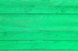 Leinwanddruck Bild - Light green wooden fence made of pine boards, green wall background, pine wood texture