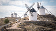 A traditional Spanish windmill in the top of a hill in the town of Consuegra, which is located in the province of Toledo, in Spain, Europe.