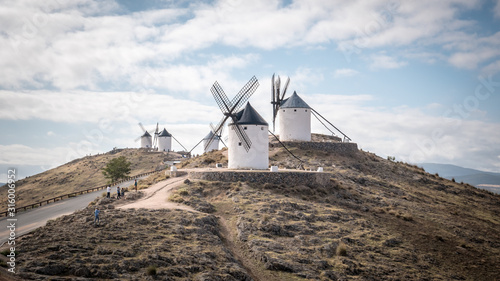 a-traditional-spanish-windmill-in-the-top-of-a-hill-in-the-town-of-consuegra-which-is-located-in-the-province-of-toledo-in-spain-europe