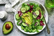Fresh Vegetable Salad With Avocado And Cucumber. Top View With Copy Space.