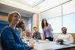 Businesswoman explaining in board meeting
