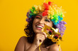 canvas print picture - Beautiful woman dressed for carnival night. Smiling woman ready to enjoy the carnival with a colorful wig and mask