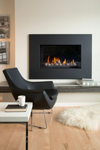 Black Armchair By Fireplace In Contemporary Living Room