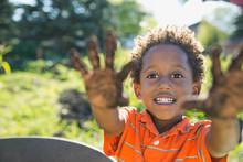 Cute Boy Showing Hands Covered In Garden Dirt