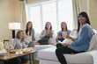 Female friends with digital tablets in living room