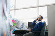 Businessman answering smart phone in office