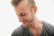 Close Up Of Smiling Blonde Man Looking Down