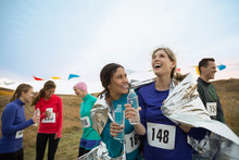 Smiling Runners Drinking Water...