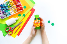 Leprechaun Paper Craft. St.Patrick 's Day. Material For Creativity. Child's Hands