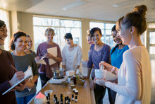 Instructor With Mortar And Pestle Explaining Essential Oils