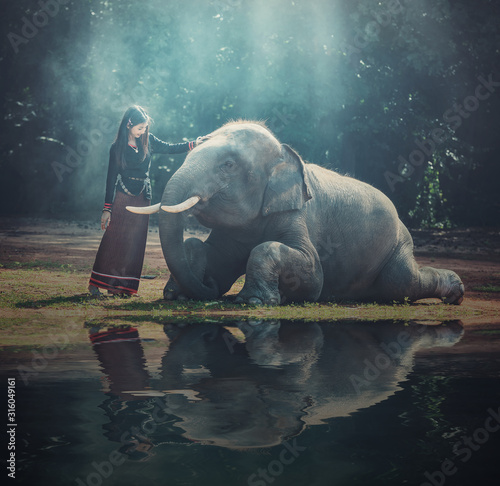 Beautiful girl with smiling elephant, elephant village, Surin, Thailand Canvas Print