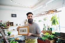 Portrait Of Terrarium Shop Owner Showing First Dollar