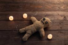 Voodoo Doll On A Wooden Backgr...