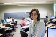 Portrait Smiling Professor In Computer Lab Classroom