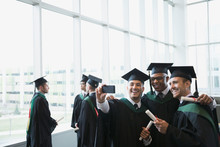 College Graduates Cap And Gown...