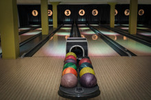 Multicolor Bowling Balls On Rack At Bowling Alley