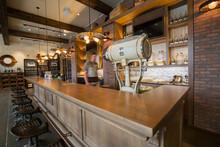 Worker Walking Behind Counter At Distillery Bar