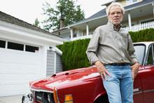 Portrait Confident Senior Man Leaning Classic Car Driveway