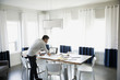Architect working at laptop on dining table