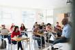 High school students listening to teacher in classroom