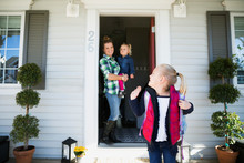 Daughter Waving Goodbye To Mother Sister Front Stoop