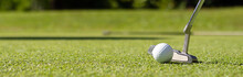 Close Up Of Golf Club And Ball In Grass.