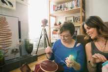 Women Enjoying Cross-stitch Pr...