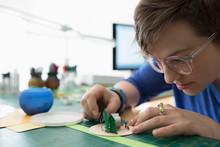 Focused Craftswoman Assembling Diorama