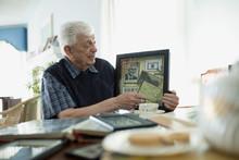 Senior Man Showing Old Memorabilia
