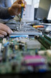 Engineer assembling laptop electronics