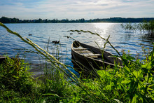 Half-submerged Wooden Boat On ...