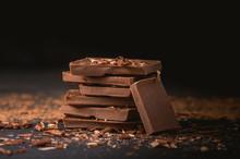 Milk Chocolate Stack On Dark Background