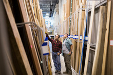 Men Discussing Wood At Home Improvement Store