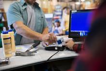 Man Paying Using Credit Card R...