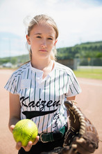 Portrait Serious Middle School Girl Softball Player Holding Glove And Softball