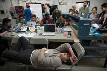 Exhausted Hacker Resting Working Hackathon In Workshop